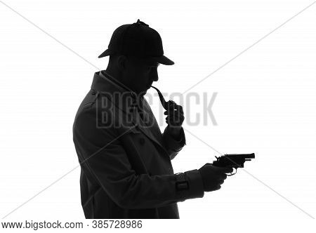 Old Fashioned Detective With Smoking Pipe And Revolver On White Background