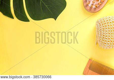 Natural Washcloth, Wooden Massage Brush, Wooden Comb On A Yellow Background, Flat Top View, Backgrou