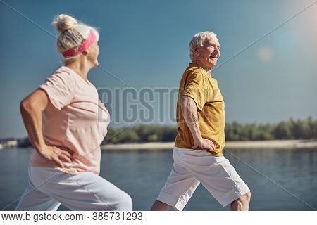 Gray-headed Woman Looking At A Man During The Workout
