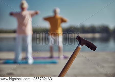 Two Elderly People Exercising On The Quay