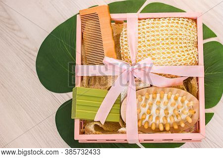 Natural Ecological Washcloth Wooden Massage Brush. Olive Soap In A Wooden Box On A Pink Background,