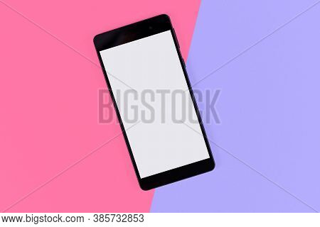 Flat Lay With Blank Black Smart Phone With Empty Screen On Pink And Violet Background