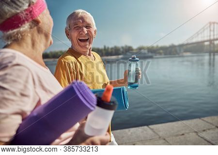 Gray-headed Sporty Lady Gazing At A Laughing Man