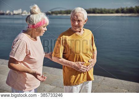 Senior Caucasian Man Experiencing A Stomachache Outdoors