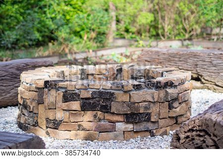 Fireplace In The Garden. Fireplace Design For Outdoor Is Circle Shape And Built By Brick. Party Conc