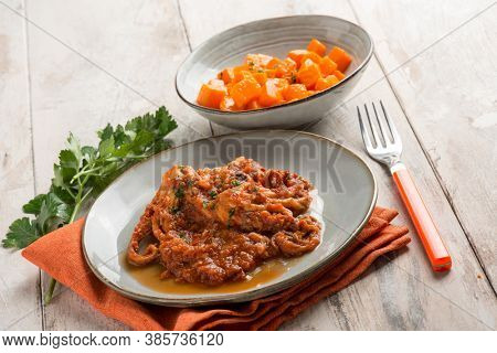 baby octopus with tomato sauce and pumpkin salad