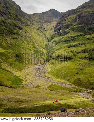 Scenic View Of Glen Coe, Scottish Highlands, Uk. Tranquil Scene Of Ravine, Stream And Mountains. Wil