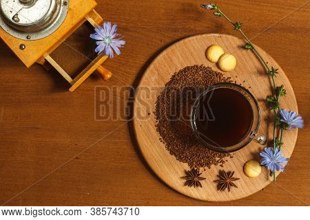 A Cup Of Ground Chicory Root Coffee On A Wooden Stand Decorated With Chicory Flowers And A Vintage C