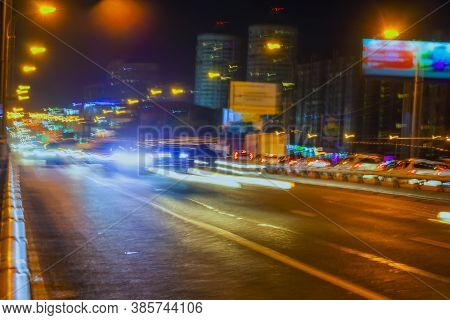 Abstract Blurred Image Of Urban Street Night Traffic, Bright City Bokeh Lights, Night Time, For Back
