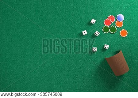 Top View Of Dice And Dice Cup And Chips On A Green Cloth. 3d Illustration.
