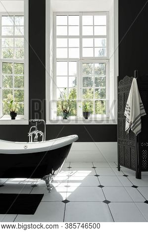 Vertical Photo Of Modern Interior Design In Contemporary Bathroom With Classic White Bath, Towel On