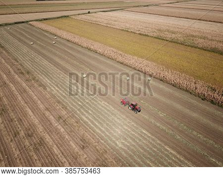 Tractor Baling Hay, On The Corn Fields