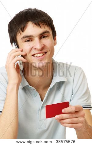 A young man with a mobile phone and a card, isolated on white background
