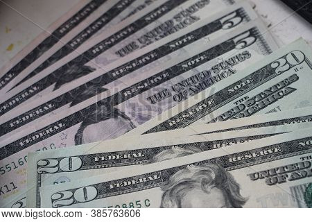 Background With Money American Dollars Bills Of Five And Twenty Dollars Worth. Money Currency Succes