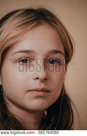 Portrait Of Little Girl Crying With Tears Rolling Down Her Cheeks. Girl Crying. Girl 9 Years Old Is