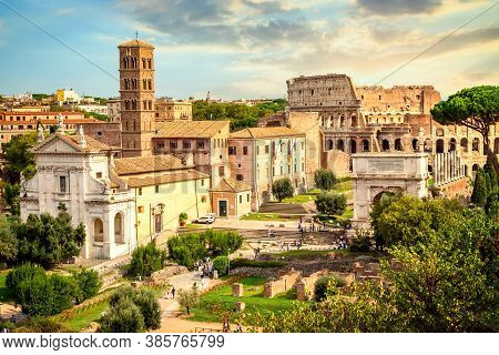The Colosseum And Arch Of Constantine In Rome, Italy During Summer Sunny Day Sunset. The World Famou