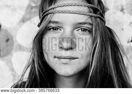 Young girl hippie style close-up portrait. Black and white photo.