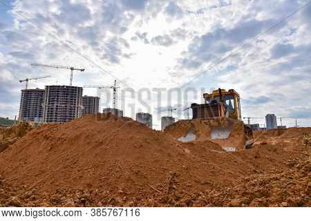 Track-type Dozer During Of Large Construction Jobs At Building Site. Bulldozer On Road Work. Land Cl