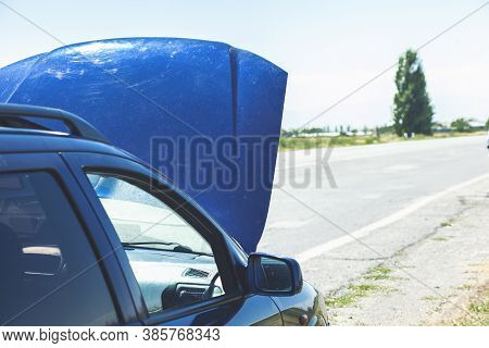 Close Up Of A Broken Down Car, Engine Open, In A Rural Area