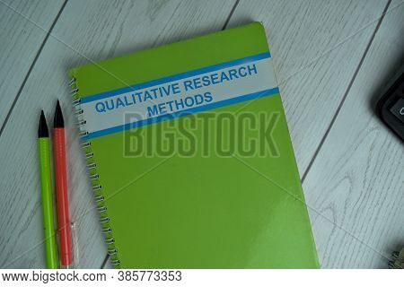 Qualitative Research Methods Write On A Book Isolated On Office Desk.