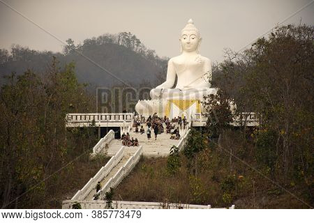 Thai People And Travelers Foreign Travel Visit And Respect Praying Buddha Statue In Wat Phra That Ma