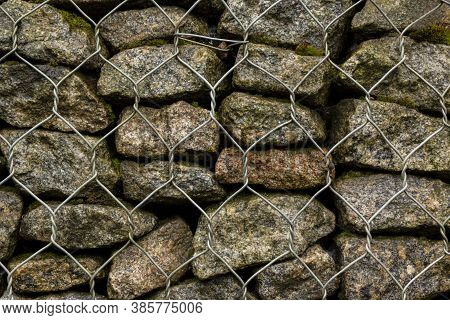Gabion Made Of Stone And Metal Wire Mesh. A Stone Wall That Uses Metal And Stone In Harmony. Ecology