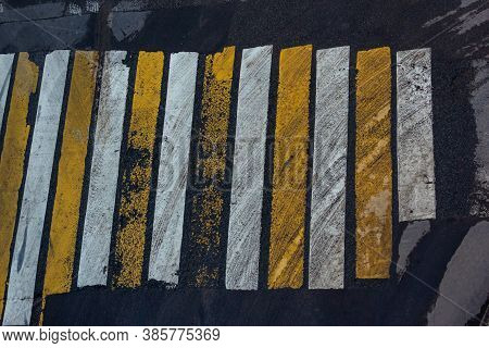 White And Yellow Stripes Marking A Pedestrian Crosswalk. Security Concept On Road, Large Crosswalk.