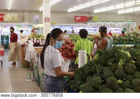 Asian Woman Long Hair Wearing Protective Face Mask  In Supermarket Department Store. Female, Looking