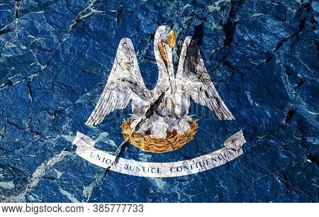 National Flag Of American State Of Louisiana Depicts A Bird's Nest In Blue In Center, Inside Which P