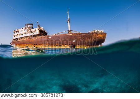 Split Shot With Wreck Ship In Blue Ocean. Arrecife, Lanzarote