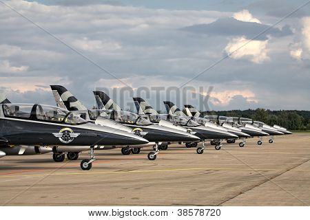 HRADEC KRALOVE, CZECH REPUBLIC - SEPTEMBER 5: Seven airplanes Aero L-39 Albatros from Breitling Jet Team on CZECH INTERNATIONAL AIR FEST 2010 on September 5, 2010