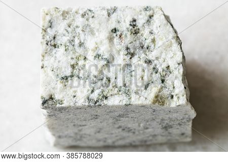 Closeup Of Sample Of Natural Mineral From Geological Collection - Rough White Granite Rock On White