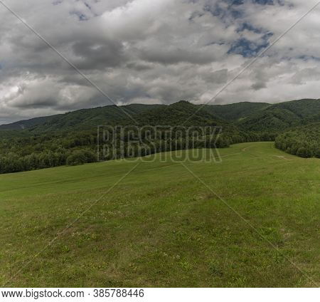 Panorama View With Meadows And Pasture Land And Gray Clouds Near Runina Village