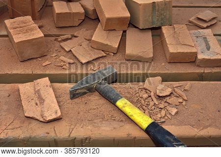 Workbench In Brick Dust, Hammer And Fragments Of Bricks, Stove Operator's Workplace