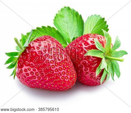 Two strawberries with strawberry leaves isolated on a white background.