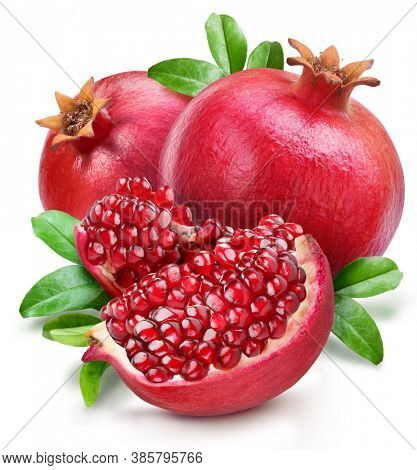 Pomegranates with leaves and pomegranate slices isolated on a white background. Clipping path.