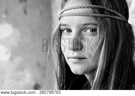 Young girl hippie. Black and white portrait outdoor.
