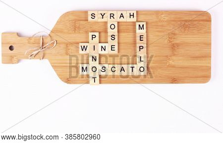 Variety Of Wines Listed In The Crossword On Handmade Cutting Board.wine's Name On Wooden Cubes.kitch