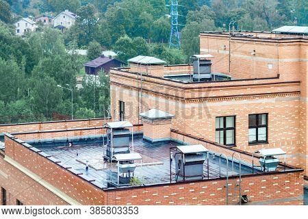 Top Modern Terrace Wet Flat Roof Apartment Building With Air Conditioners Green City View Rain Autum