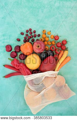 Fruit & vegetable collection very high in lycopene for a healthy heart with plant based foods also high in antioxidants, anthocyanins, dietary fibre, vitamins & minerals. Immune defence concept.