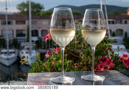 Tasting Of Local White Wine In Summer With Sail Boats Haven Of Port Grimaud On Background, Provence,