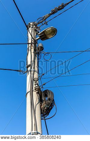 Electric Pole With Wires And Power Equipment. Street Light Electricity Front View Isolated With Blue