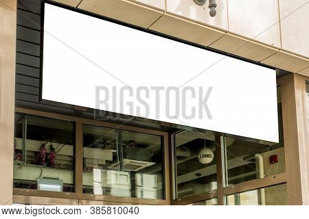 Horizontal Black Empty Signage On Clothes Shop Front With Glass Windows
