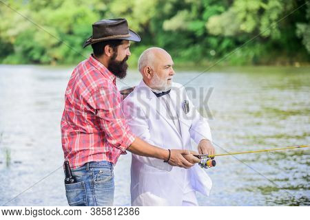 He Need Help. Hobby And Recreation. Two Fishermen With Fishing Reel. Family, Granddad And Drandson F