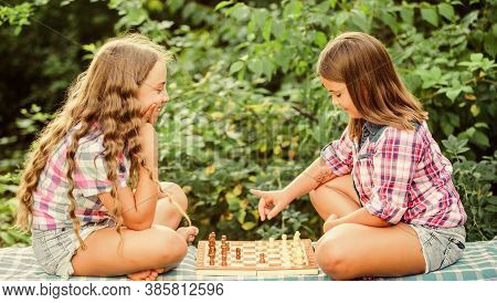 Sport And Hobby Concept. Little Girls Play Chess. Sisters Playing Chess. Cognitive Development. Inte