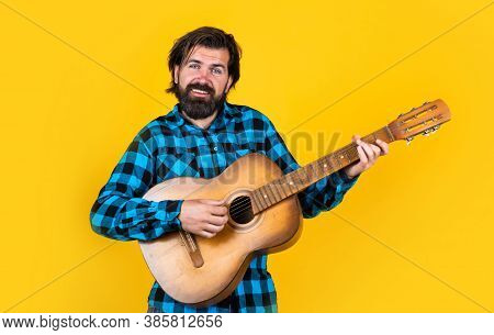 Musical Instrument. Playing The Guitar On Party. Old Fashioned Bearded Hipster Play String Instrumen