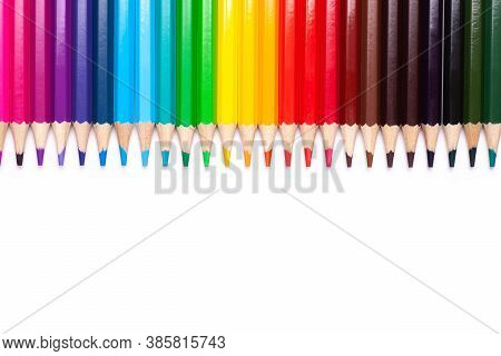 Multicolored Wooden Pencils In Rainbow Shades In Line On A White Isolated Background Mock Up, Horizo