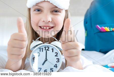 Back To School. Alarm,clock. Little Happy Girl Sleeps In Bed. Schoolgirl Wakes Up Early To Study. Ba