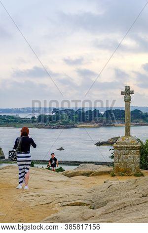 Ile De Brehat, France - August 27, 2019: Tourists At Viewpoint Near Celtic Cross La Croix Maudez On