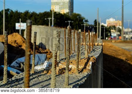 Rusty Pins Sticking Out Of Concrete Blocks. Laying Of Blocks For The Construction Of A New Building.